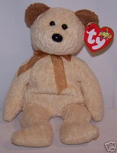 Huggy the Bear is in mint condition, with all tags intact and in great shape. This Beanie comes from a loving, smoke and pet free home. Beanie Baby Bears, Baby Beanies, Beanie Babies, Ty Bears, Big Eyes, Plushies, Baby Items, Teddy Bear, Pets
