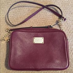 """Authentic Michael Kors purse-like new Authentic Michael Kors cross body purse-like new. Wine/Maroon color with pretty chain accents on the strap. Purchased at Nordstrom last year and used for one vacation only. Interior clean and like new. 2 very tiny surface scratches as seen in last pic, not noticeable unless you are examining purse closely. Measures approx 10""""x7"""" Michael Kors Bags"""