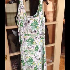 """Fit and flair painterly flower print Pretty flower and leaf print. Pure white with shades of green and black. No belt, but has loops. Looks cute with thin or wide black, white or green. Cotton with spandex. To the knee at 39"""" and chest is 20"""". Back zip. Has stretch. No lining. Breakin Loose Dresses"""