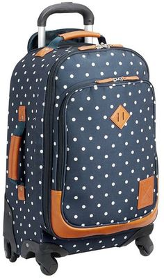 The perfect travel companion for any adventure, this hold-everything spinner rolls smoothly on four in-line wheels and features a spacious interior with multiple pockets. A delightfully dotted allover print brings chic style to superior function.