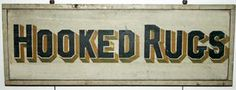 "Hooked Rugs Trade Sign  Vermont, Ca. 1920     Colorful 2-sided pine sign with applied molding. Unusual subject matter in a period sign.     38"" wide x 13"" high x 1 3/4"" deep.       SOLD"