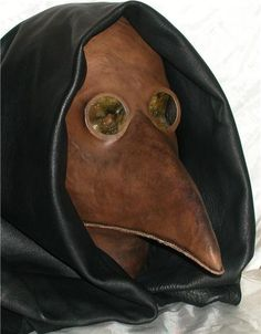 OMG.... .. want want want. i may make my own for halloween!!!  Leather Plague Doctor Mask Steampunk. $130.00, via Etsy.