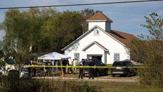 Law enforcement officials works at the scene of a fatal shooting at the First Baptist Church in Sutherland Springs, Texas, on Sunday.