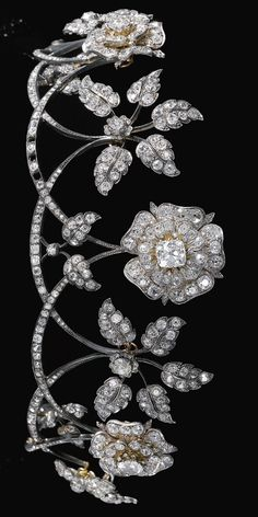 Diamond tiara, late 19th century. Designed as a graduated series of swags each surmounted alternatively with floral and foliate motifs, set with cushion-shaped, circular-cut and rose diamonds, inner circumference approximately 250mm, each floral and foliate motif detachable, accompanied by five brooch fittings, a few small diamonds deficient, case stamped Raff. Fecarotta & Co.