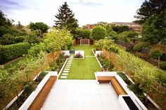 Family garden divided into three areas with childrens play area at far end. Hood practical design for a family