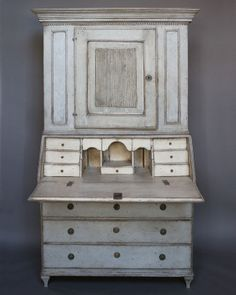 """Period Gustavian secretary with library, Sweden circa 1820. The upper library section has two shelves behind the raised panel, reeded door and dentil molding under the cornice. The lower section has three large and one small drawer under the slant front. Inside is a fitted interior with two disguised drawers. The original brass hardware has unusual covered escutcheons. Solid oak construction.  H:81"""", W:44"""", D:20"""".  Ref. #33-16"""
