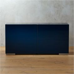 Shop navy blue lacquered credenza. Clean lines in glossy navy lacquer span almost five feet to broaden storage options. Low-profile frame with expansive top can even pedestal a widescreen.