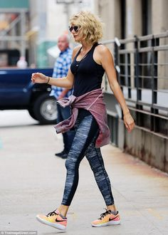 Working on her fitness: Looking sporty in patterned leggings and a black tank…