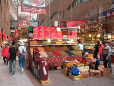 The Erdaoqiao Market and Grand Bazaar in Urumqi, Xinjiang, China, presents a colorful scene. Urumqi, Grand Bazaar, Fun Activities, Places To See, Road Trip, Asia, Street View, Boat, Tours