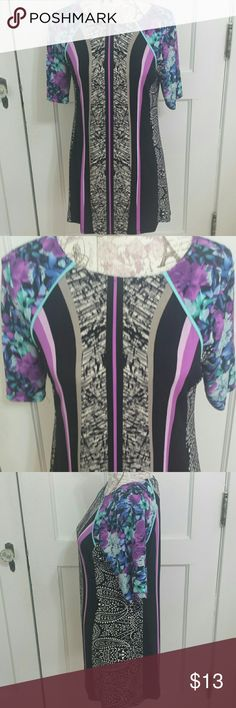 """Style & Co. Top.NWOT Floral half sleeves (just above elbows) Vertical pattern on body. Purples, blues, lt green,black, white & gray.  29"""" long.  18"""" armpit to armpit lying flat. 95% poly 5 % spandex.  Petite/Medium Excellent Condition. Style & Co Tops"""