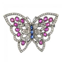 A diamond and gem-set butterfly brooch.