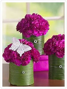 FUSCIA & GREEN CENTERPIECE this is pretty minus the flutter by. Look at the container wrapped in leaves! Genius!