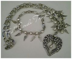 The wings of angels necklace and bracelet by FullCircleTreasures