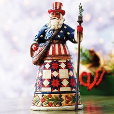 Jim Shore® American Santa  Smithsonianstore.org  From the 'Santas Around the World' series by American folk artist Jim Shore, this kindly Father Christmas is distinctively garbed and accessorized.  The Stars and Stripes American Santa has an eagle belt buckle and a Statue of Liberty staff.  Stone resin. 7.25 inches high.