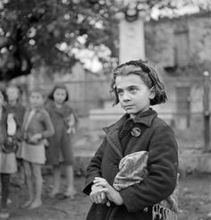 """hauntedbystorytelling: """" Voula Th. Papaioannou :: Portrait of a girl, Distomo, Greece, 1945 / src: Benaki Museum more [+] by this photographer """" Greece Pictures, Old Pictures, Old Photos, Victory In Europe Day, Benaki Museum, Greece History, Greece Photography, Documentary Photography, Historical Photos"""