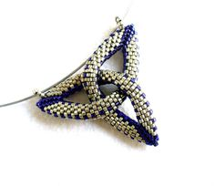 Hey, I found this really awesome Etsy listing at http://www.etsy.com/listing/154984797/celtic-knot-pendant-bead-trefoil-trinity