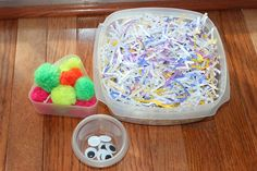 Fuzzy Monster Collage Craft using shredded paper. Fun, sensory craft project for toddlers and preschoolers.