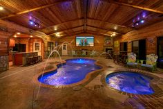 Incredible 6 bedroom mansion with private indoor heated pool, pool theater, outdoor covered living area, sun deck, wood burning fireplaces, full kitchen.