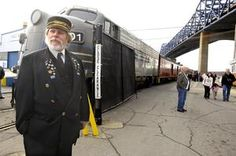 In the shadow of the #BragaBridge, Cape Cod and Central Railroad conductor Dana Rowe stands in front of the dinner train as arriving passengers board.