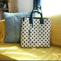 "Polka-dot Tote bag With Matching Wallet This tote has the cutest pattern of black polka dots with black interior and handles. Height is about 13.5"", width about 13"". There are handles to make this tote a large handbag, or you can attach the strap to make it a shoulder bag. It also comes with a wallet ! Charming Charlie Bags Totes"