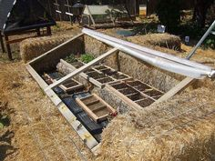 Cold frame built with bales of straw by terriem on Flickr (cc)