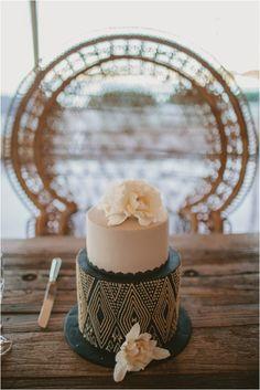 Black, blush and gold wedding cake.