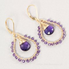 Wire wrapped amethyst hoops in 14kt gold filled by BellesBijouxDesigns