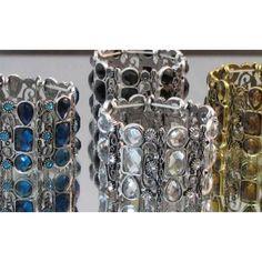 Bracelet élastique de couleur argent orné de cristaux clairs, bleus, noirs ou doré.