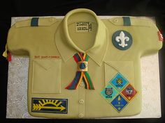 Cake that looks like a boy scout/camping shirt!