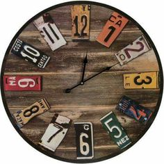 Clock made from an old barrel lid and license plates