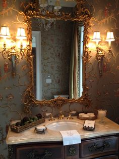 The Enchanted Home: chinoiserie front bath idea, tray of potpourri, pretty towels, useful disposable towels, tray of soaps, soap dish, candle in crystal, nothing over toilet
