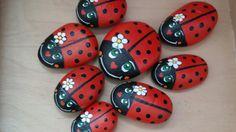 Lots of ladybirds, handpainted stones
