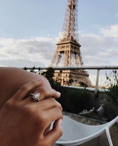 paris france engagement honeymoon pear shaped diamond engagement ring eiffel tower love travel destination wedding