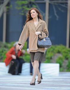 Amy Adams carrying a Gucci Fall Winter 2013-14 moss python Lady Lock handbag.