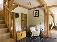 A spacious hallway with oak framing and a gorgeous feature oak staircase