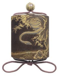 A black lacquer four-case inro  By Koma Ryusei, 19th century
