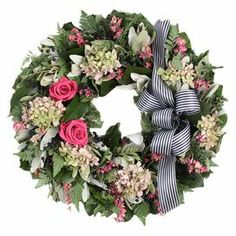 "Preserved wreath with pink roses and hydrangea.  Product: Preserved wreathConstruction Material: Silicone, natural twigs and ribbonColor: Multi Features: Includes preserved roses and hydrangeasRibbon accent includedDimensions: 16"" Diameter  Cleaning and Care: Wipe gently with a dry cloth"