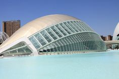 """This modern building called """"Hemisferic"""" is an IMAX cinema, planetarium and laser show. It looks like a huge eyelid in the man made lake in Valencia."""