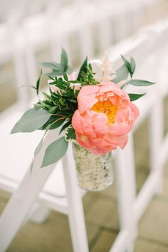 Coral charm peony ceremony chair decor: http://www.stylemepretty.com/canada-weddings/alberta/2016/02/12/pink-woodland-fairytale-mountain-wedding/ | Photography: Corinna Walker - http://www.corrinawalker.com/