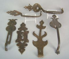 Pennsylvania wrought iron hardware to include a tulip form hasp, heart cutout escutcheon, 3 door handles, and a hinge.