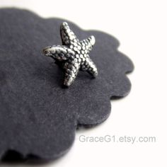 Starfish cartilage earring.