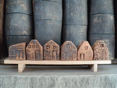 tiny clay houses on a bench