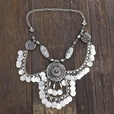 Child of Wild Indian Silver Statement Piece Bestseller : Silver necklace adorned with hanging aluminum coins Handmade in Mumbai Hook Closure Hindu significance: the representation of the past present
