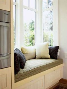 Cozy window seat in kitchen area...sounds good to me!