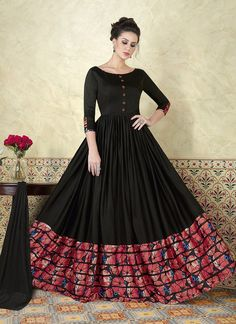 Be the sunshine of everybody's eyes dressed in this charming look black floor touch anarkali dress. The ethnic print work with a dress adds a sign of elegance statement with a look. Comes with matching bottom and dupatta Costumes Anarkali, Anarkali Gown, Saree Dress, Anarkali Suits, Lehenga Choli, Cotton Anarkali Dress, Indian Gowns Dresses, Pakistani Dresses, Flapper Dresses