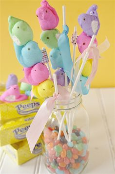 Peeps on a Stick ~ What a cute arrangement & yummy to eat! Buy Peeps in all colors, skewer them on Lollypop sticks, fill vase/Mason jar with Jelly Beans, add ribbon to other lollypop sticks & you have it! OR you can put them in plastic bags, tie with ribbon & give as gifts!