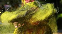 An Indian woman shakes her head covered in colored powder as she celebrates Holi, the Hindu festival of colors, in Mumbai India, Monday, March Holi Photo, Holi Powder, Holi Festival Of Colours, Holi Celebration, Festival Photography, Hindu Festivals, Happy Holi, Nature Pictures, Color Splash