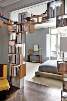 Gamper created the openwork shelving between the master bedroom and the smoking room | archdigest.com