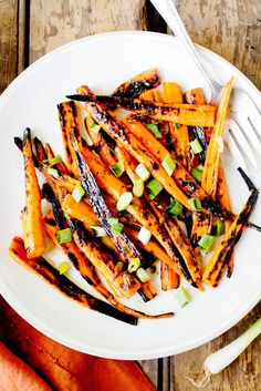 These glazed carrots, from Karen and Quinn Hatfield of the Los Angeles restaurant Odys and Penelope, are caramelized and sweetened from a quick hot turn on the grill, then tossed in a salty dressing of soy sauce, balsamic vinegar, garlic and ginger. (Photo: Rikki Snyder for The New York Times)