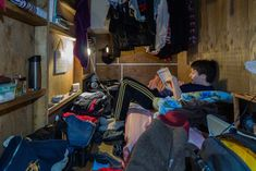 Eye-Opening Portraits of People Living in Cramped Capsule Hotels Hidden in Tokyo - My Modern Met